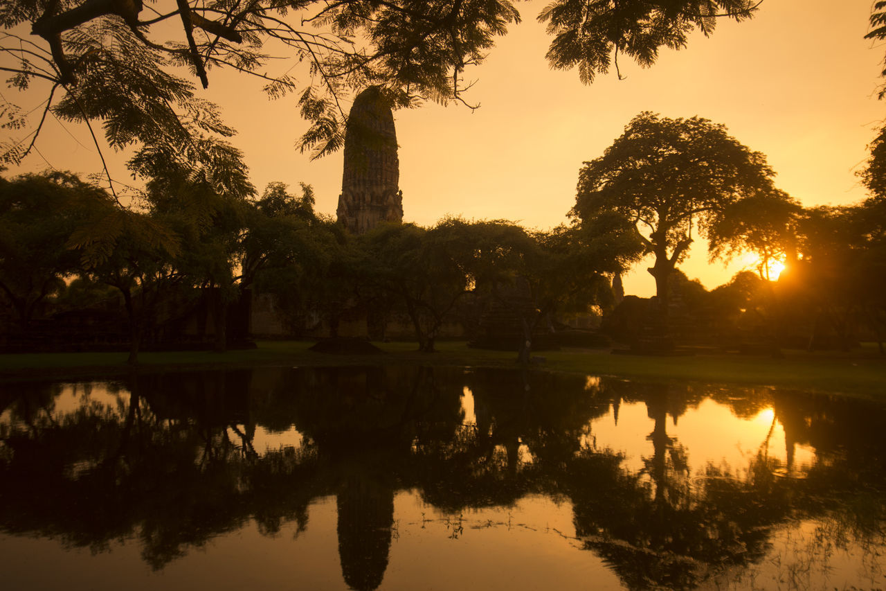 reflection, tree, sunset, silhouette, history, water, nature, built structure, lake, no people, architecture, ancient, growth, outdoors, travel destinations, beauty in nature, sky, scenics, day