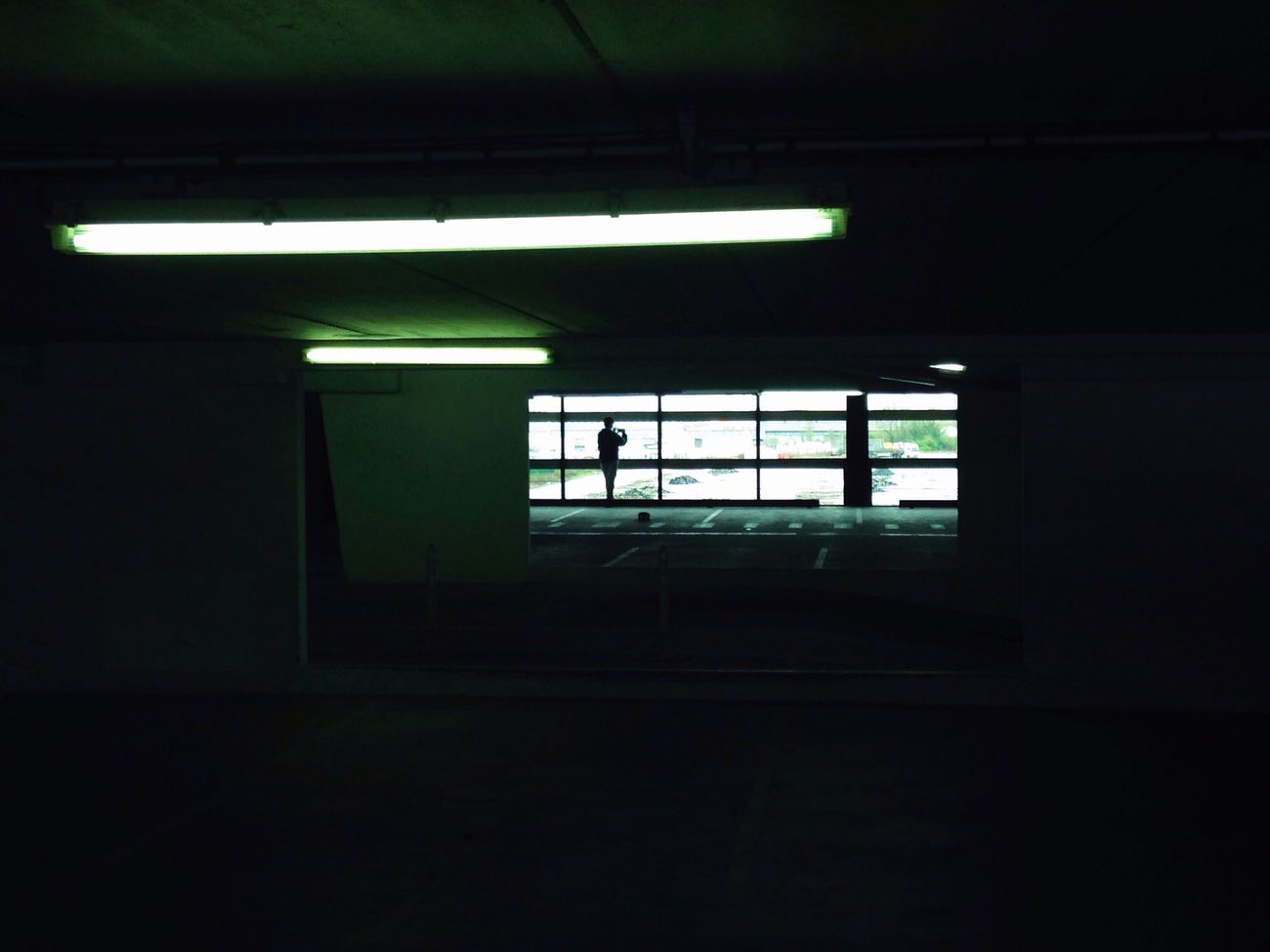 Cutting space. Indoors  Architecture Built Structure Day Illuminated Silhouette Greenish Light And Shadow Car Park Tungsten