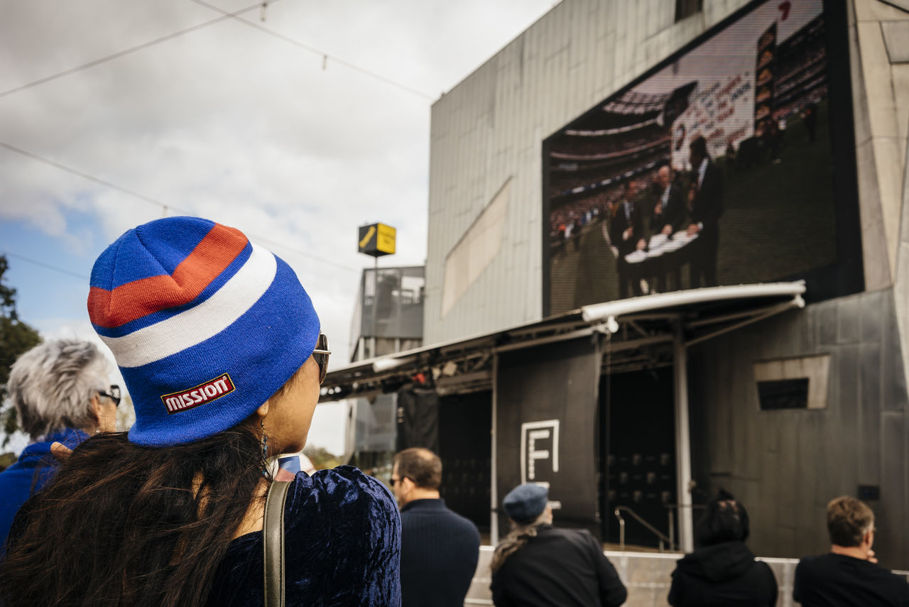 1st October 2016, thousand of footy fans gathered at Federation Square, Melbourne, to watched live telecast game of the Grand Final 2016 between Western Bulldogs and Sydney Swans. The Bulldogs had beaten Sydney by 22 points in a thrilling game that ended the club's 62-year wait for the title. Many Victorians, including myself, were supporting the Bulldogs throughout the game. Casual Clothing City City Life Crowd Everyday Australia Footy Looking MelbournePhotographer People Watching Person Rear View Sony Australia SonyA7s Streetphoto_color Streetphotography Streets Of Melbourne VSCO Western Bulldogs
