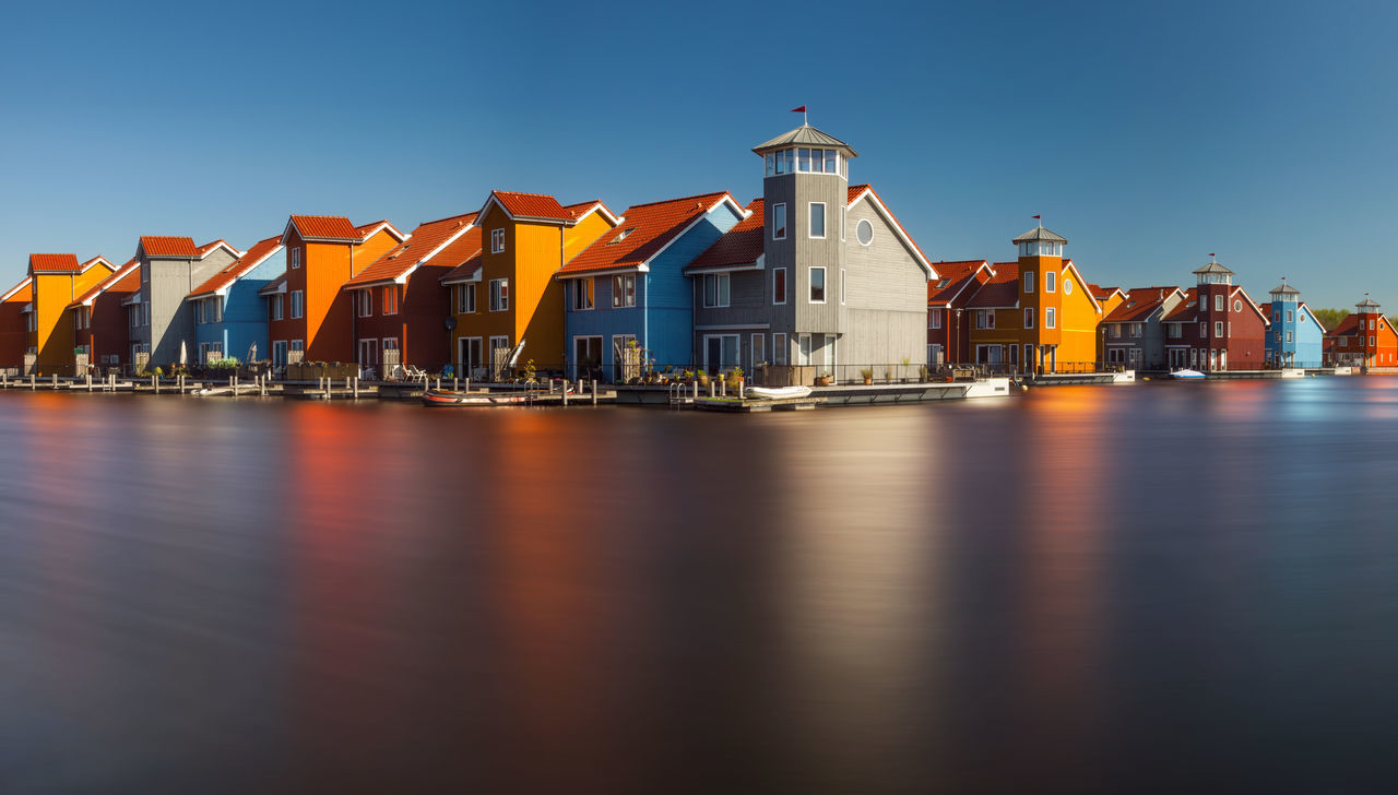 Residential quarter from Groningen, Netherlands. Architecture Blue Sky Buildings City City Life Cityscapes Colorful Exterior Groningen Harbor Holland Houses Lake Modern Netherlands No People Panorama Reflection Residential Building Residential District Town Water Wooden