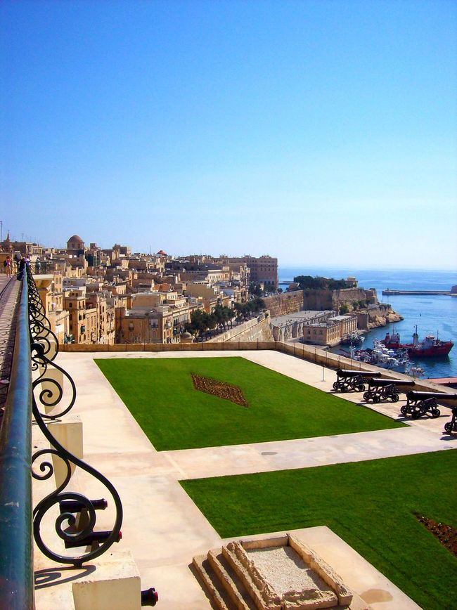 Architecture Blue Building Exterior Built Structure City City Life Cityscape Clear Sky Day Famous Place Footpath Green Color Malta Outdoors Residential Building Residential District Scenics Sea Tourism Tourist Resort Tranquil Scene Tranquility Travel Destinations Vacations Water