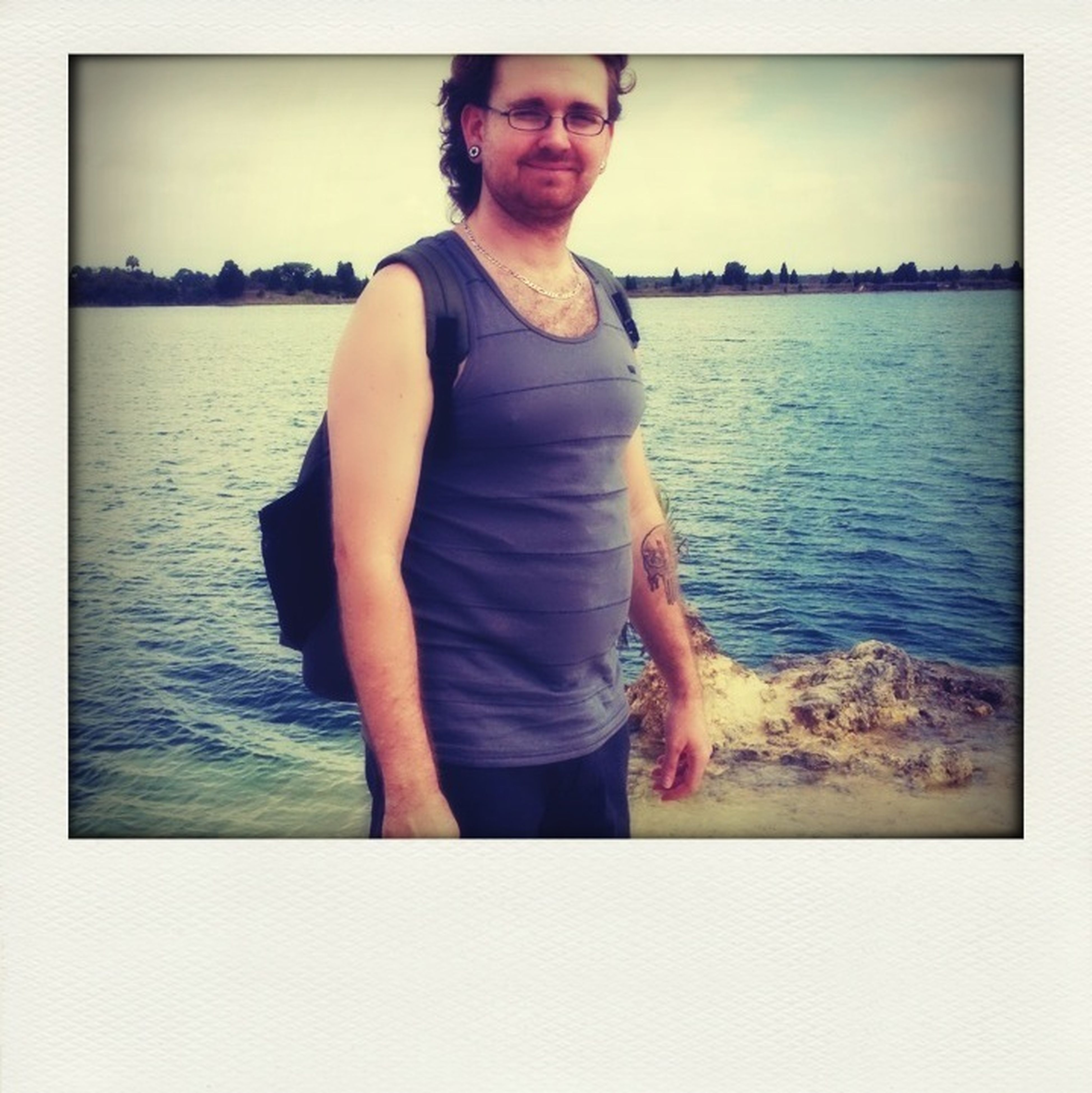 transfer print, water, person, lifestyles, auto post production filter, young adult, portrait, leisure activity, looking at camera, casual clothing, sea, standing, front view, young men, full length, sitting, sky, three quarter length
