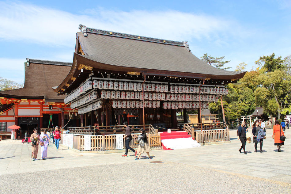 Tourist enjoy sightseeing at Yasaka Shrine Buden Hall Dance Stage, Kyoto Adult Adults Only Architecture Building Exterior Built Structure City Day Japanese Culture Kyoto, Japan Men Outdoors People Senior Adult Sky Spring Sunlight And Shadow Sunny Day Travel Destinations Women Yasaka Shrine Young Adult