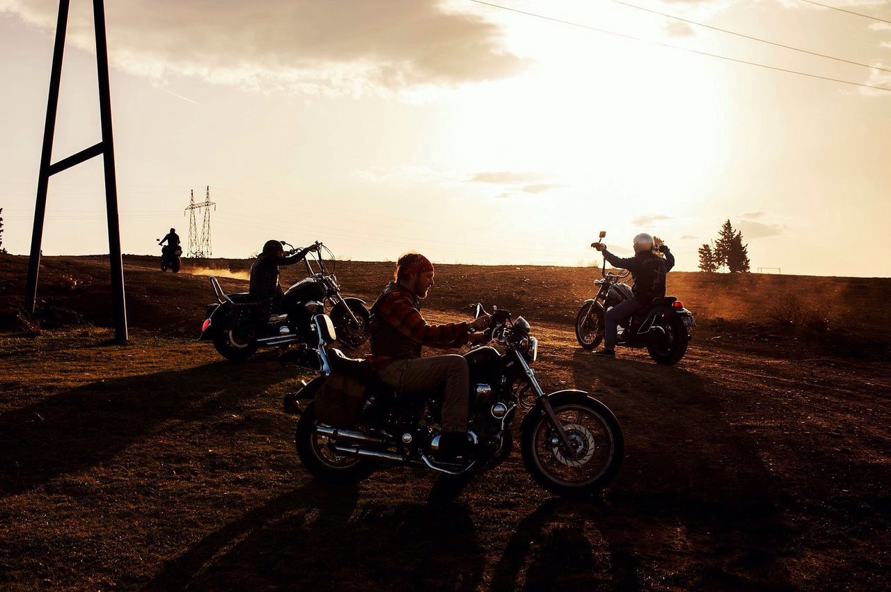 Transportation Motorcycle mode of transport riding adventure land vehicle full length sky motocross people outdoors sunset friendship Adult men Adults Only headwear sports race day