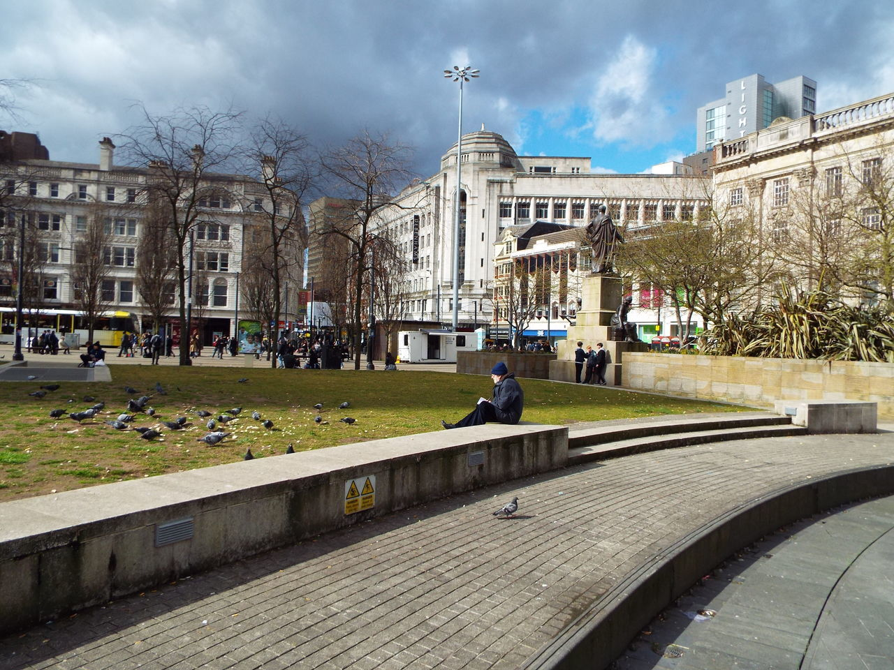 Somebody sat relaxing watching the birds in Manchester Piccadilly Gardens surrounded by the busy city life outside the gardens with people shopping and working in the city centre Manchester Piccadilly Gardens Manchester City Centre City Centre City Life City View  Busy City Busy Life Busy People Busy Busy Busy Relaxing Sat Watching The Birds Birds In The City Birds Pigeons The Street Photographer - 2016 EyeEm Awards