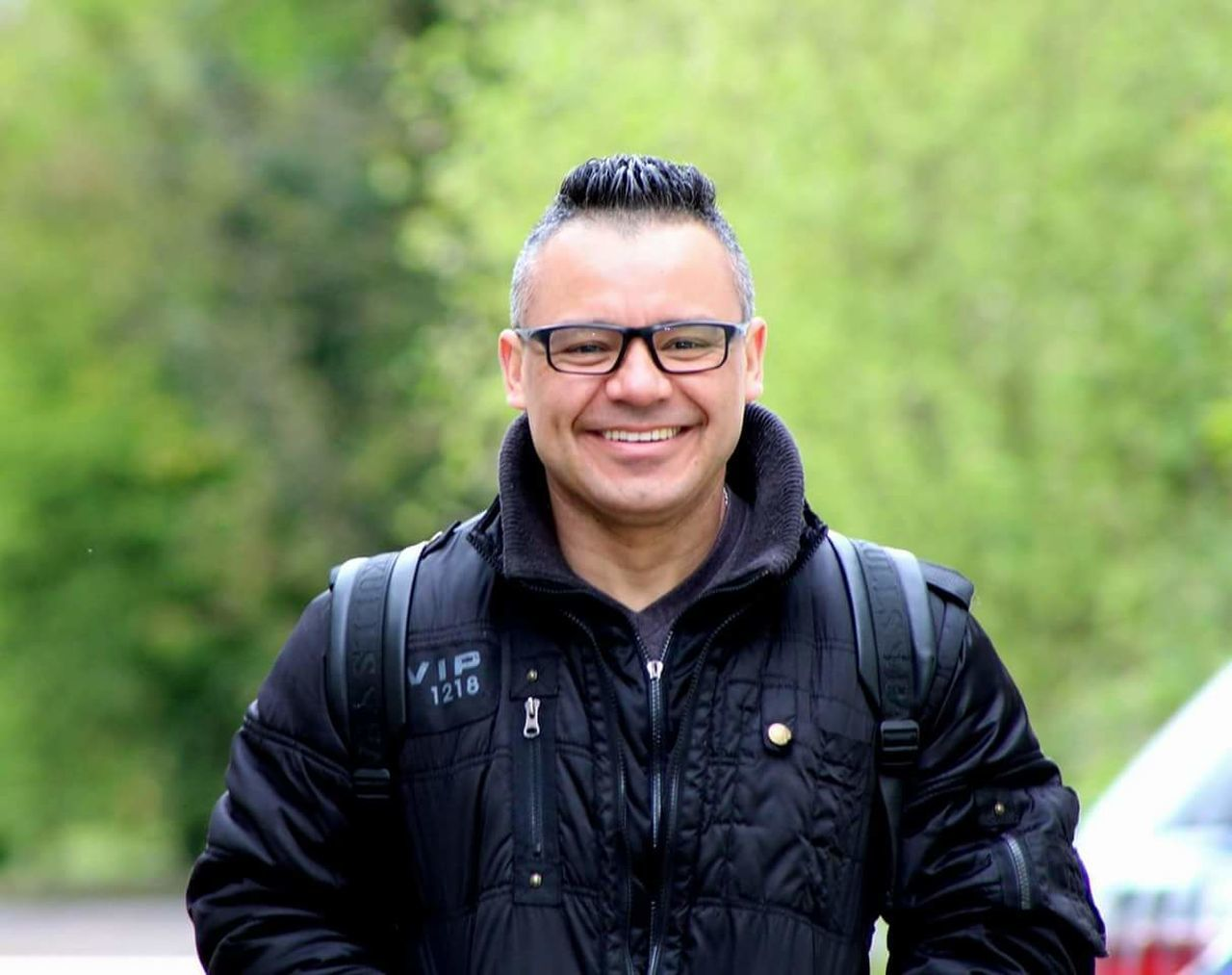 smiling, real people, front view, looking at camera, focus on foreground, mid adult, outdoors, one person, portrait, happiness, day, leisure activity, standing, lifestyles, eyeglasses, nature, young adult, one man only, adult, adults only, people