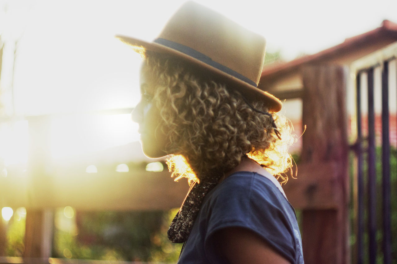 Casual Clothing Curls Getting Inspired Golden Hour Hat Head And Shoulders Lifestyles Light And Shadow Light Leak Person Portrait Real People Stylish Sunlight Young Adult Young Women Let Your Hair Down Uniqueness