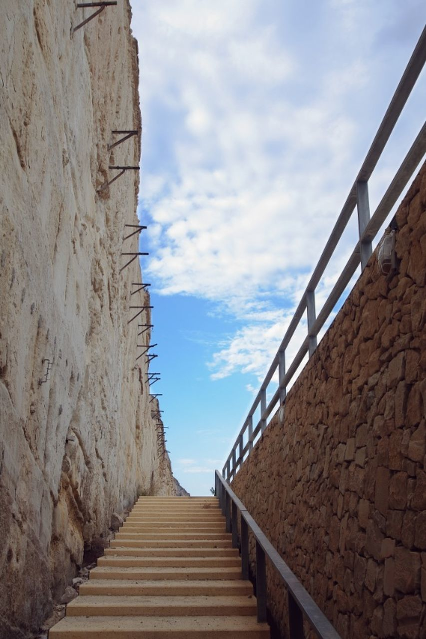 sky, railing, day, cloud - sky, built structure, tranquil scene, sea, steps, steps and staircases, water, outdoors, the way forward, no people, nature, architecture, scenics, beach, beauty in nature, building exterior, retaining wall, hand rail