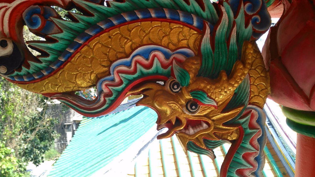 chinese dragon, multi colored, animal representation, low angle view, dragon, day, architecture, no people, statue, outdoors, built structure, building exterior, close-up