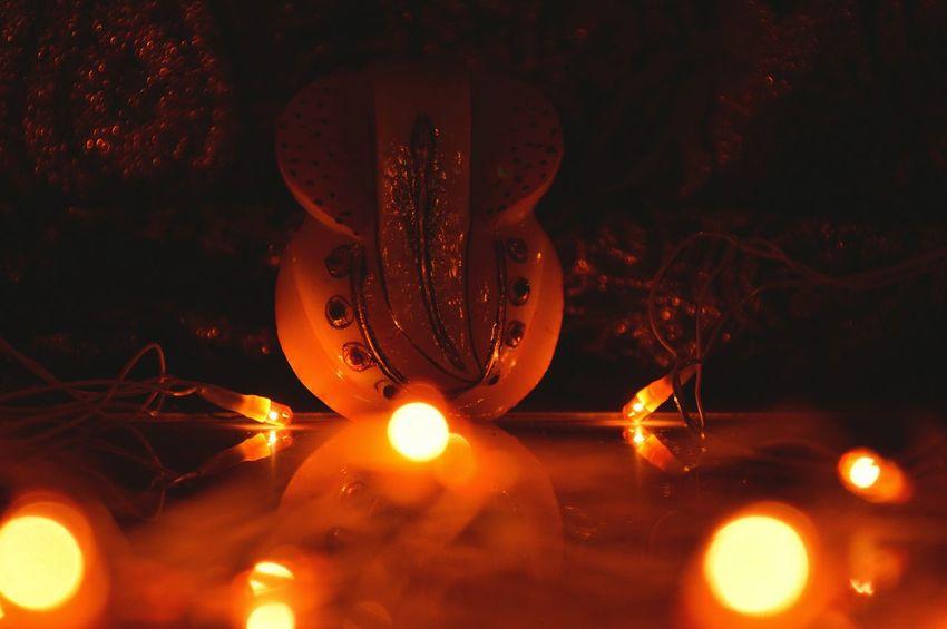 Illuminated Close-up Bokeh Photography Lord Ganesha Yellowlight