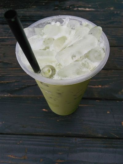 Green tea milk Drinks Meal Milk Table Cafe Thailand Lifestyles Chon Buri Menu Ice Milk Sweet Green Tea ❤️ Green Tea Milk Green Tea Flavor Green Tea Cool Cup Tabletop Wooden