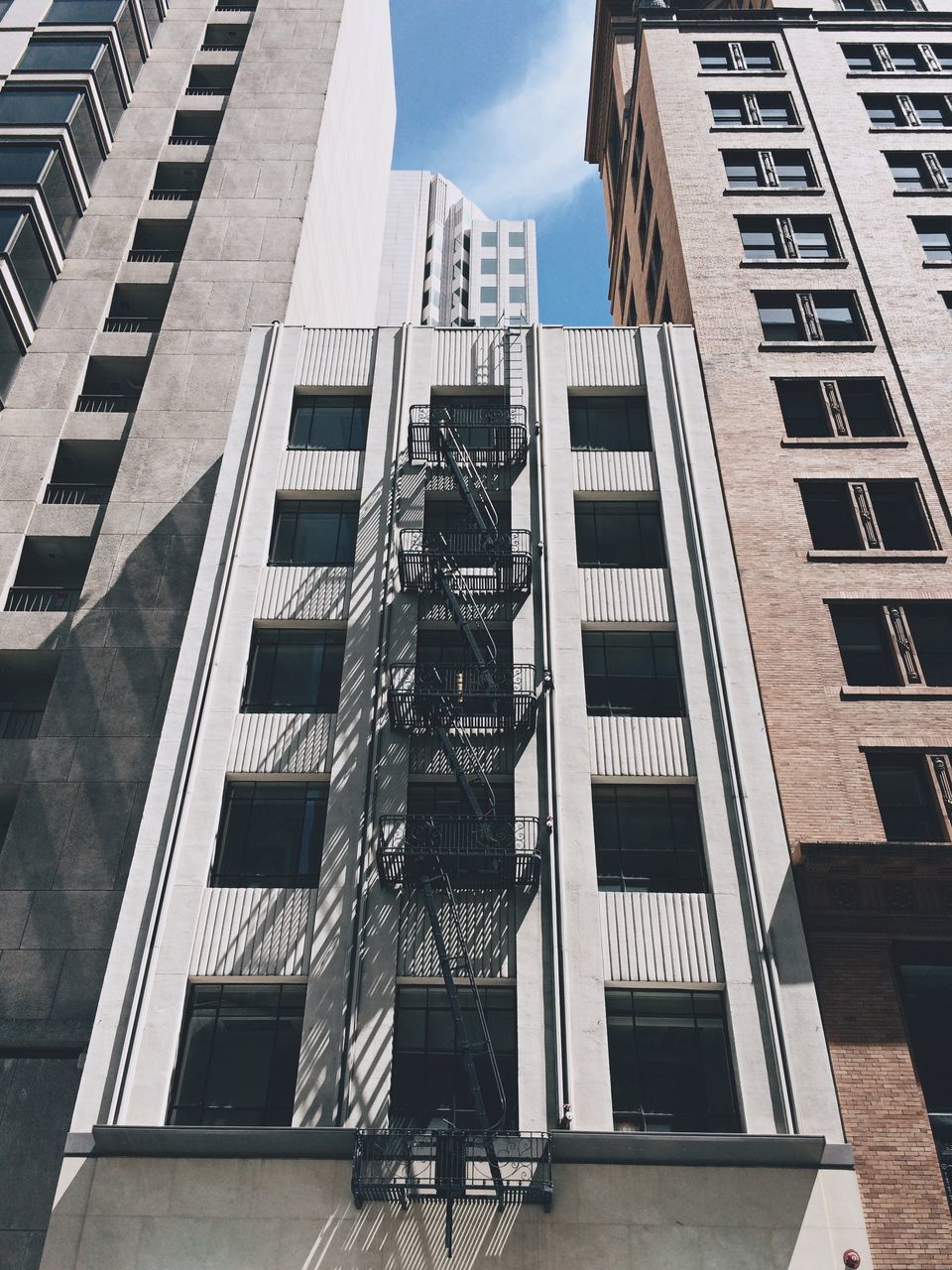 Low Angle View Of Fire Escape In Building Against Sky