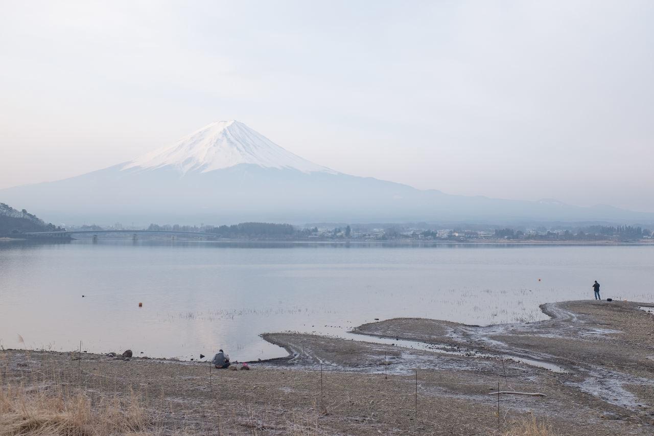 Calm Lake Against Mountain Peak