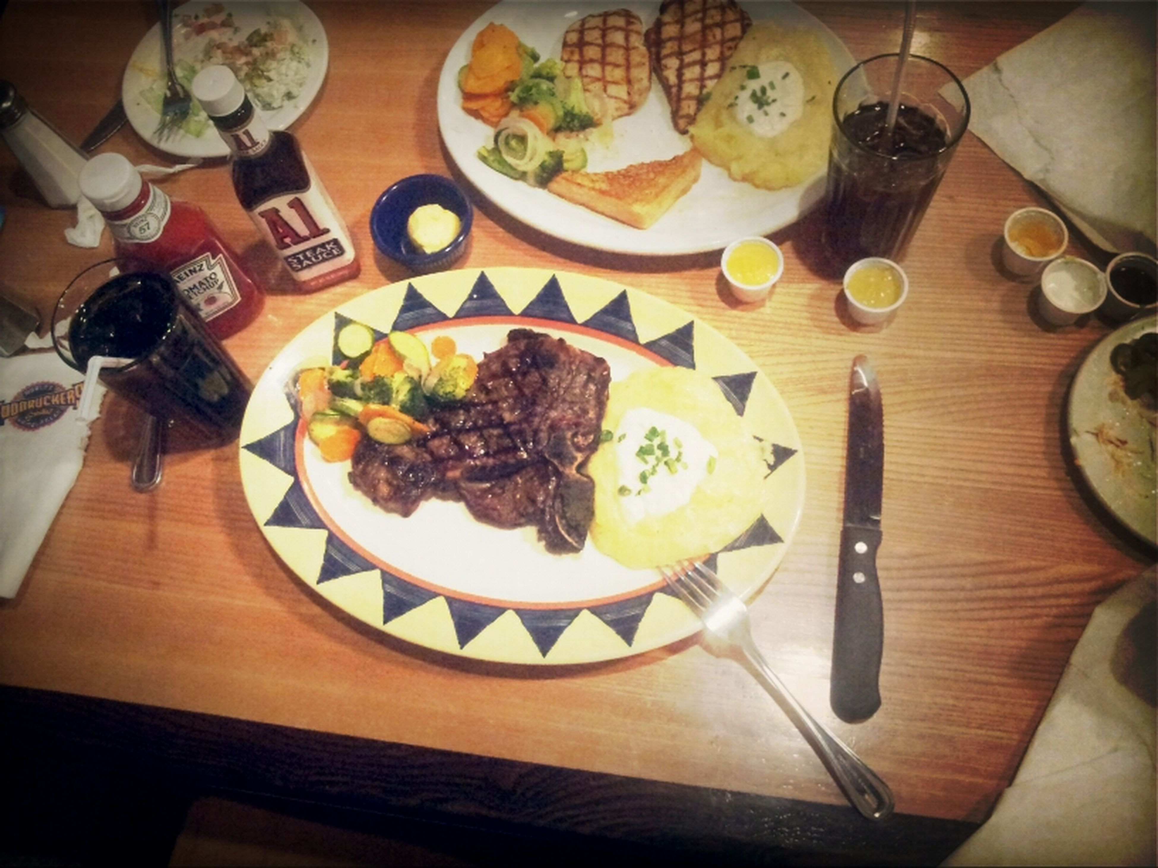 indoors, food and drink, food, table, freshness, plate, ready-to-eat, still life, fork, healthy eating, high angle view, meal, serving size, served, indulgence, wood - material, restaurant, meat, table knife, seafood