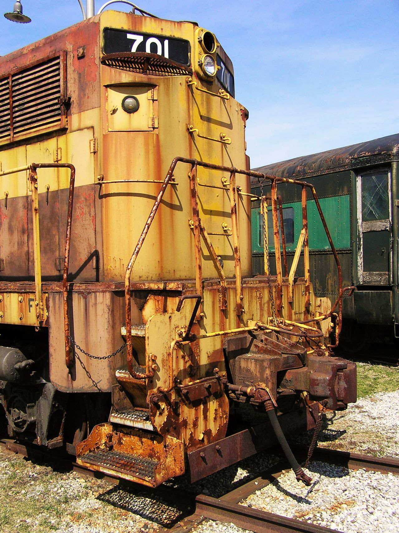 Architecture Battered Coupler Day Diesel Engine Handrail Metal Locomotive Engine Metal Ladder No People Outdoors Railroad Rust Train Engine Work Horse Yellow Color