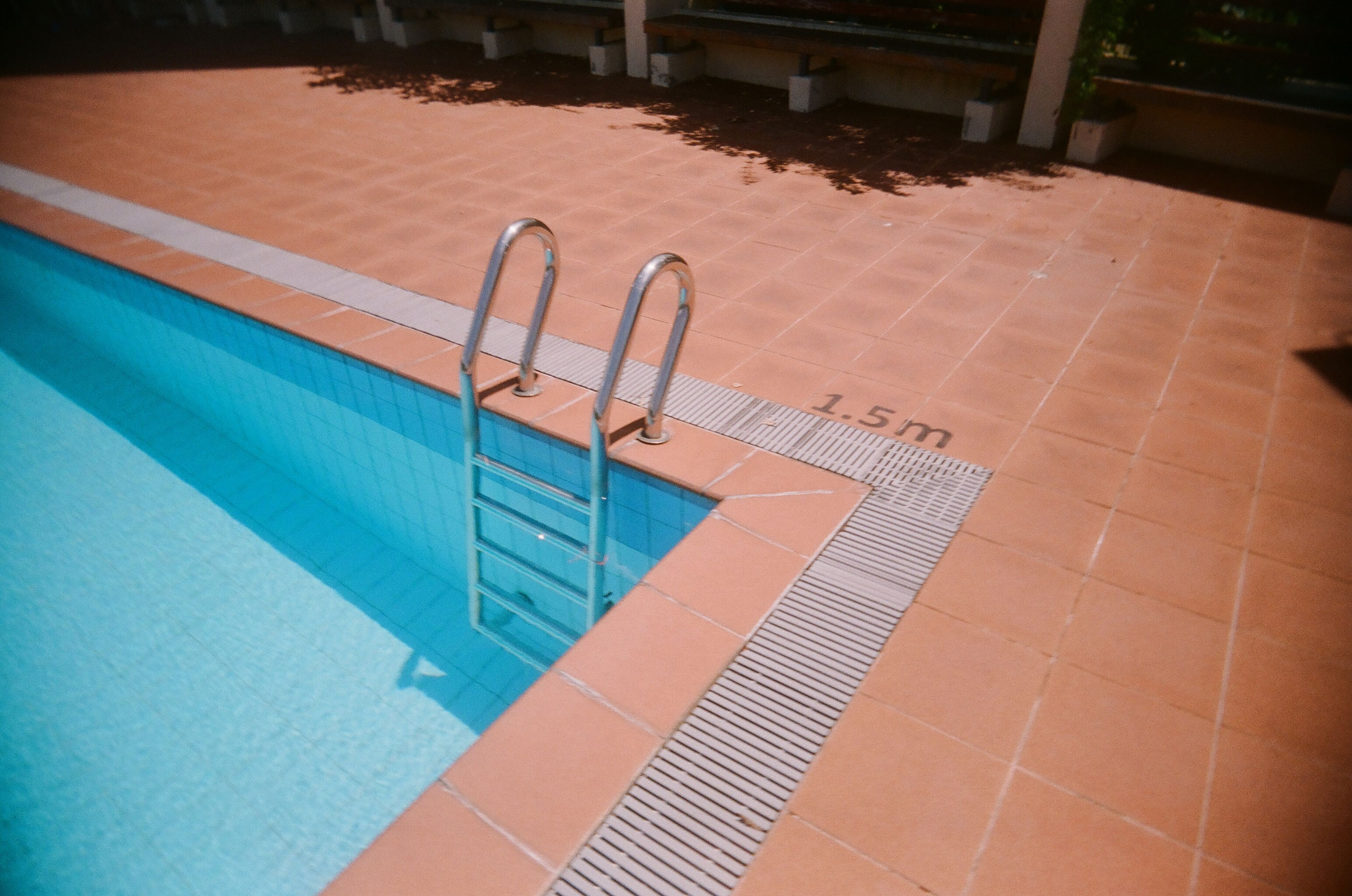 swimming pool, high angle view, absence, water, outdoors, steps, no people, day, tile