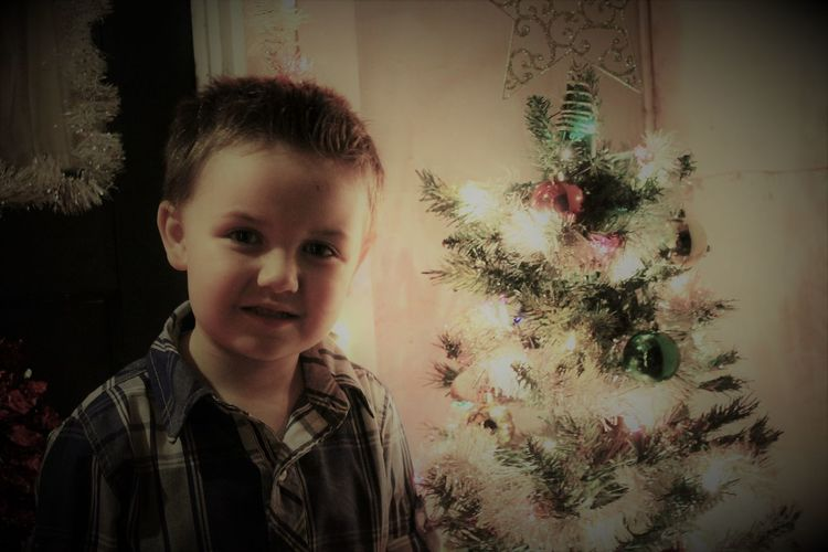 Childhood Christmas Christmas Decoration Christmas Ornament Christmas Tree Grandson Headshot Illumunated Looking At Camera One Boy Only One Person People Portrait Real People Smiling Tree
