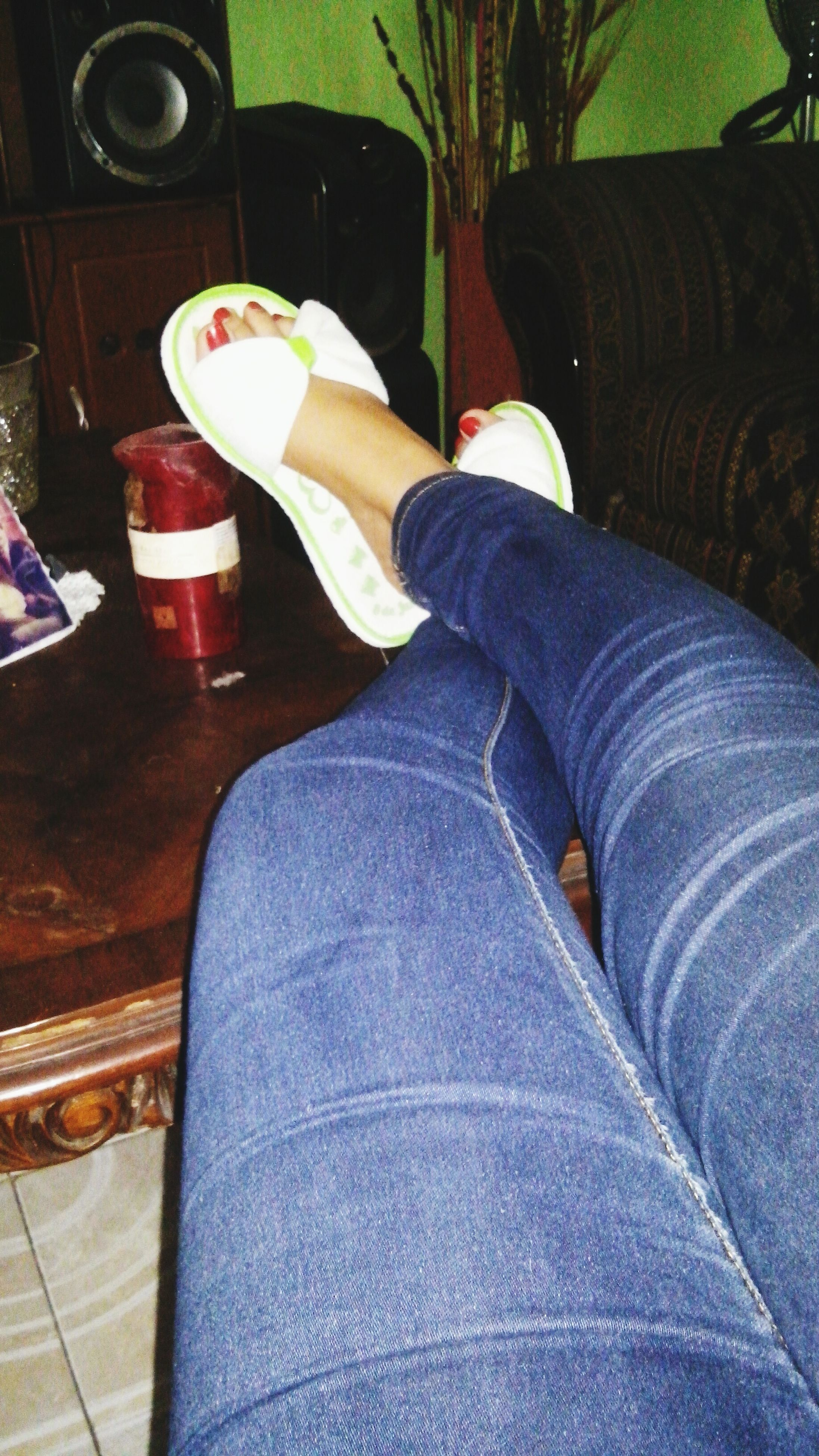 low section, person, shoe, indoors, personal perspective, lifestyles, jeans, human foot, high angle view, sitting, men, relaxation, leisure activity, casual clothing, standing, chair, footwear