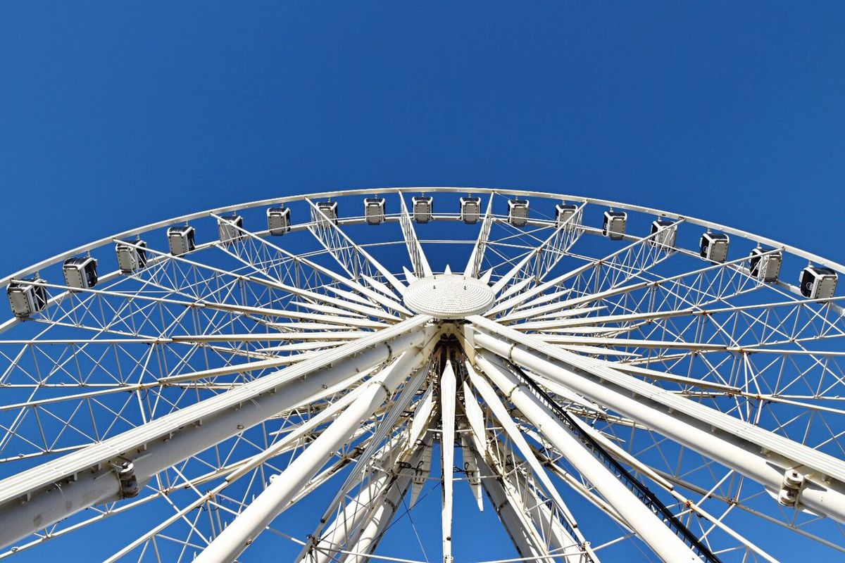 Underneath the Ferris wheel. Blue Clear Sky Low Angle View No People Arts Culture And Entertainment Amusement Park Outdoors Day Ferris Wheel Big Wheel Eyeem Community Ferris Wheel EyeEm Masterclass Blue Sky Looking Up EyeEm Gallery Big Wheels EyeEm Best Shots Different Points Of View Urban Exploration Getty X EyeEm in Liverpool