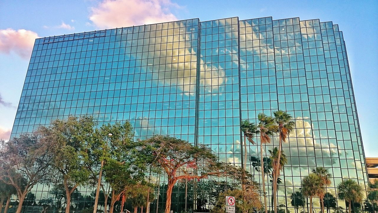 Bank of America Financial center in Fort Lauderdale, Florida Built Structure Architecture Reflection Reflections Reflection_collection Reflection Photography Reflection Perfection  Reflections In The Glass Windows Reflection On Building Reflectionphotography Reflection Obsession Reflections ☀ ReflectionPerfection! Reflection_shotz Reflection Perfection  BuildingPorn Building Building Exterior Buildings & Sky Building And Sky Building Reflections Building Reflecting The Clouds Sky Clear Sky Outdoors