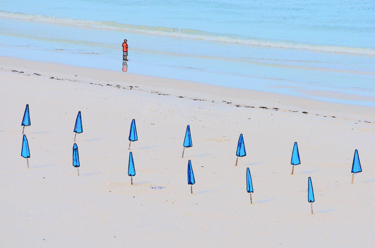 Clearwater beach Florida, effect is built into the Niko D7000 Beach Beach Life Beach Lifestyle Beach Photography Beach Umbrella Beachphotography Blue Blue Umbrellas Cartoon Closed Umbrella In A Row Large Group Of Objects Lonley Nikond7000 Ocean Parasol Shore Tranquil Scene Tranquility Umbrella Vacations Variation Waves