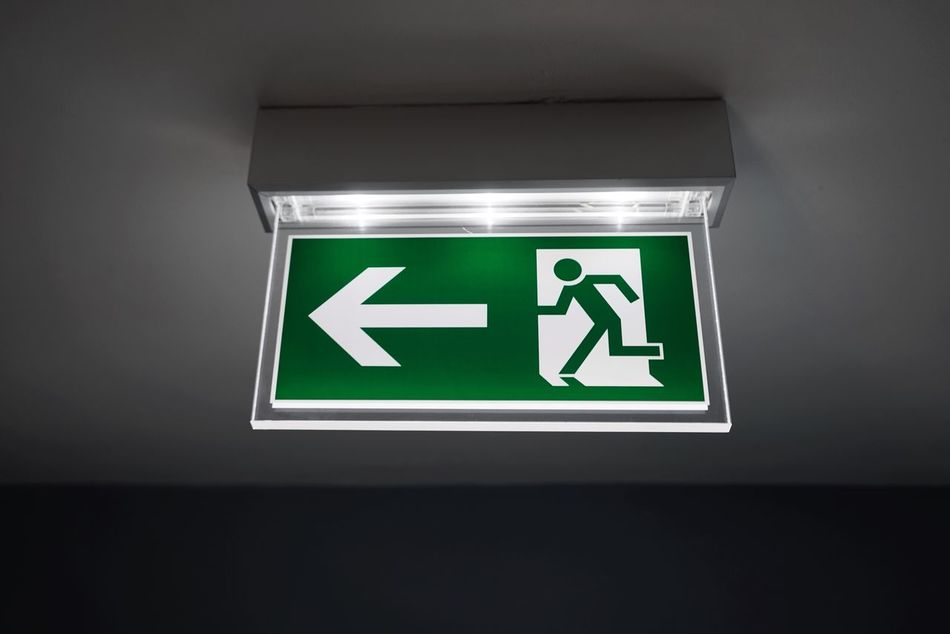 Green Color Indoors  Human Representation Safety Ceiling Illuminated Exit Sign No People Communication Close-up Day