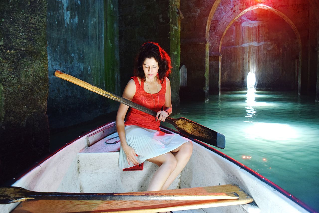 Sitting Water One Person Real People Beauty Lights Waterfront Pink Color Neon Cave Tunnel Sailing Boat Portrait Outdoors Nautical Vessel Young Adult Oar Adult People One Woman Only Young Women Rowing Adults Only Gondola - Traditional Boat Neon Life