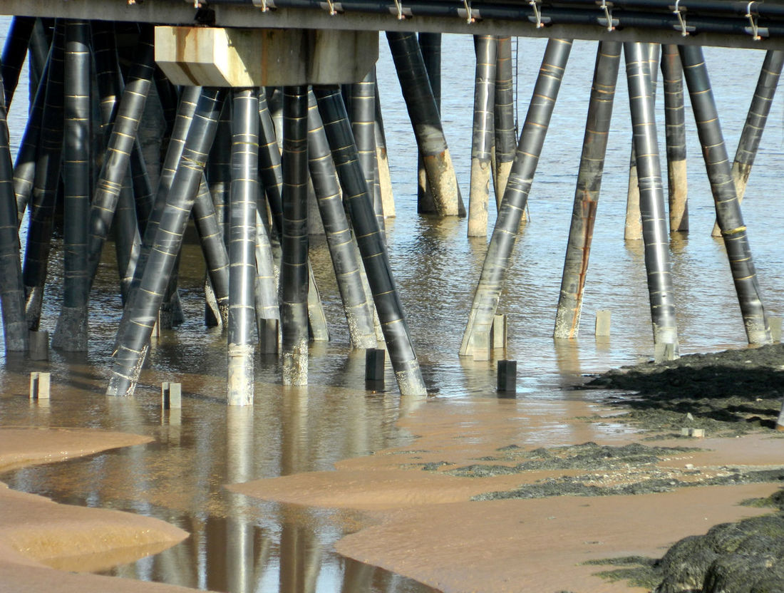 Beachphotography Day Low Section Nature No People Outdoors Pilons Reflection Sandy Beach Sea Water Water Reflections