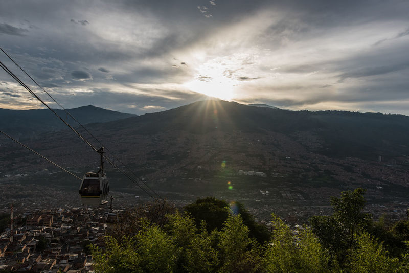 Cable Car City City Life Cityscapes Colombia Favelas Gondola Landscape Medellin City Medellín Mood Moody Sky Social Issues South America Sunrays Sunset Travel Travel Photography Embrace Urban Life An Eye For Travel Mobility In Mega Cities