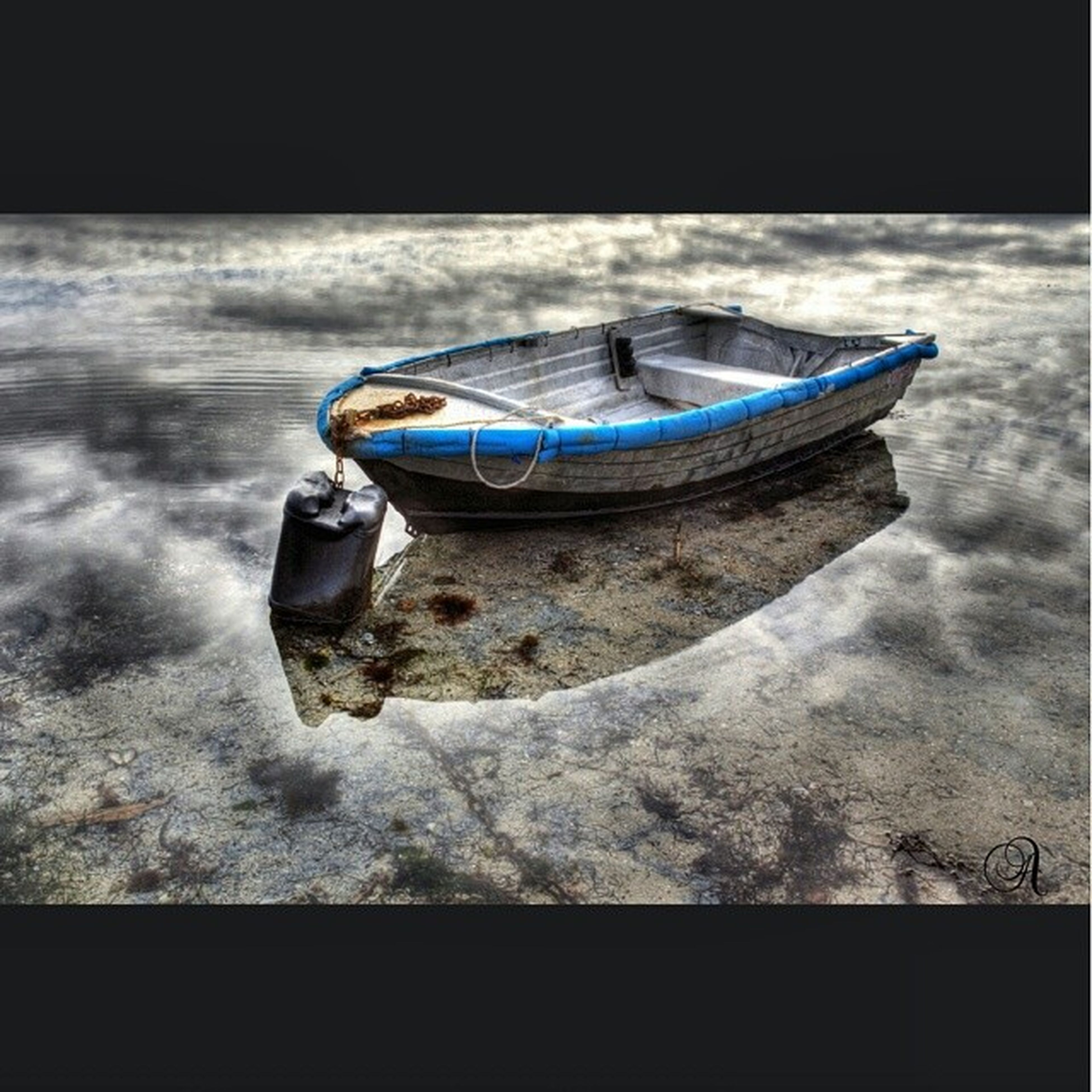 nautical vessel, boat, transportation, mode of transport, water, moored, sea, nature, day, outdoors, lake, side view, rope, blue, one animal, rock - object, tranquility, travel, no people, selective focus