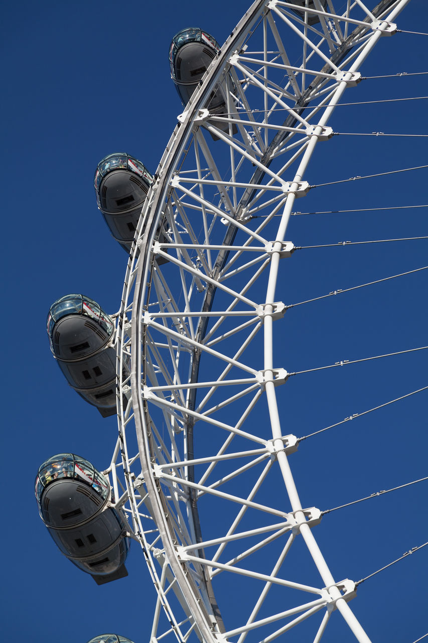 low angle view, blue, arts culture and entertainment, clear sky, amusement park, no people, day, amusement park ride, outdoors, big wheel, sky, ferris wheel