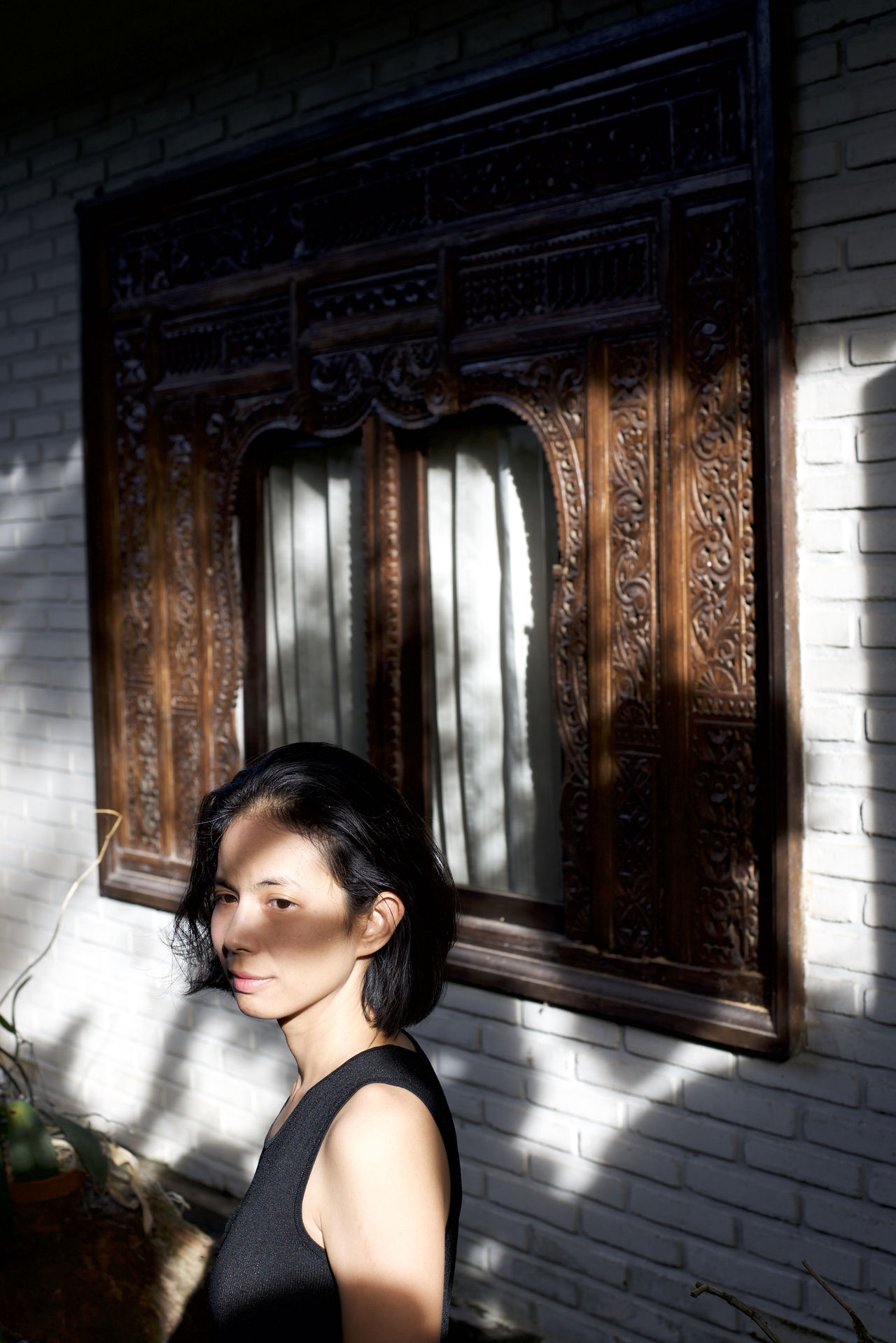 Asian Girl Bali Balinese Architecture Beautiful Woman Black Hair Brick Wall Copy Space Head And Shoulders Light And Shadow Moody Natural Light Portrait Place Of Heart Portrait Of A Woman The Portraitist - 2017 EyeEm Awards Waist Up White Wall Window