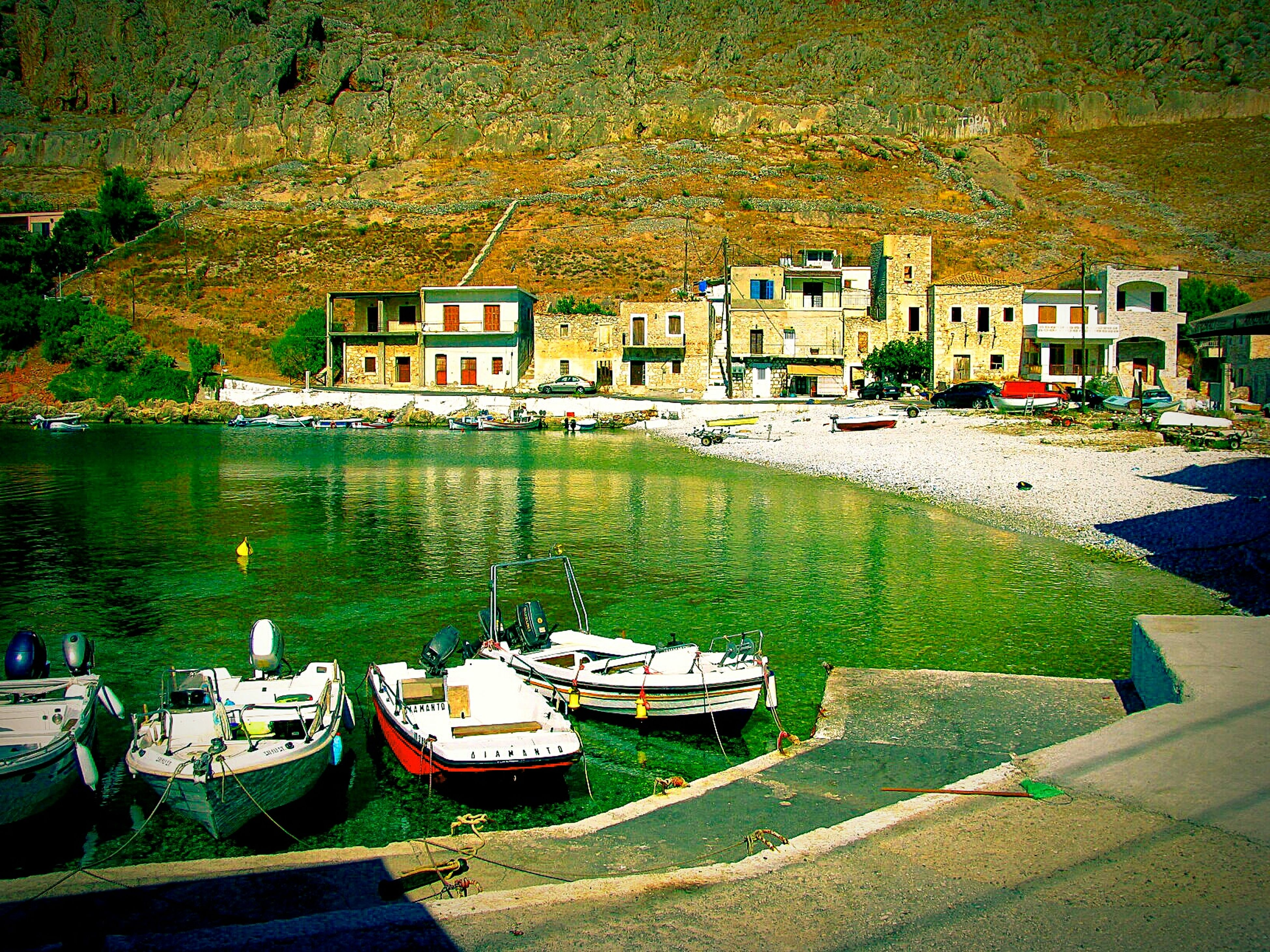Port Village Beach Beach Photography Life Is A Beach Bay Houses Peace And Quiet Tranquil Scene Tranquility Pebble Beach Boats Trawlers Gerolimenas Mani Lakonias Greece The KIOMI Collection Small Port Pebbles Pebbles And Water Tower Houses Crystal Clear Waters Landscapes With WhiteWall Miles Away