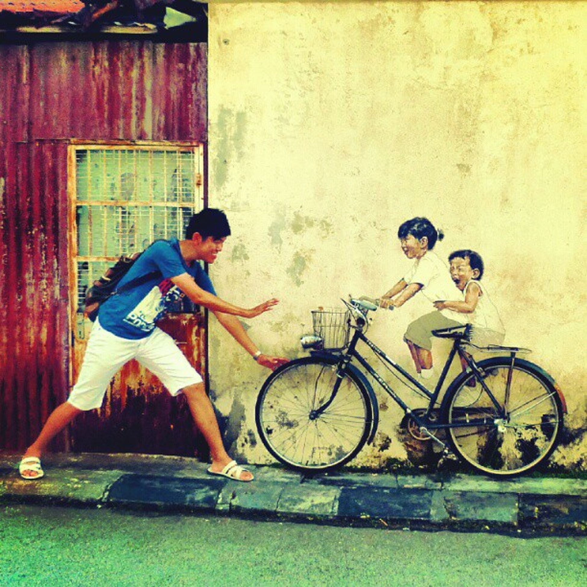 stop, i wanna have a ride as well... Penang Old Street Malaysia Georgetown Armenian mural littleboy littlegirl riding bicycle happy wall painting ig iger igmalaysia instagram like follow trip travel lumix camera 槟城 壁画 马来西亚 旅游