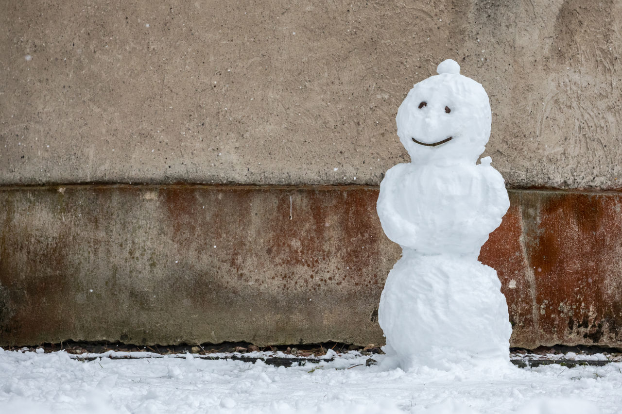 Beauty In Nature Cold Temperature Creativity Day Fun Nature No People Outdoors Playing Smile Smiling Snow Snowing Snowman Wall - Building Feature White Color Winter