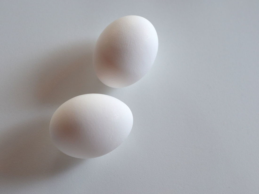 Two White Eggs Close-up Egg Eggs Electricity  Food, Geometric Shape Grey Background Indoors  Ingredients Low Angle View Nature No People Oval Oval Shape Pair Serene Peace Shape Still Life Studio Shot Together Forever <3 Two Two Objects Two Of A Kind White White Color