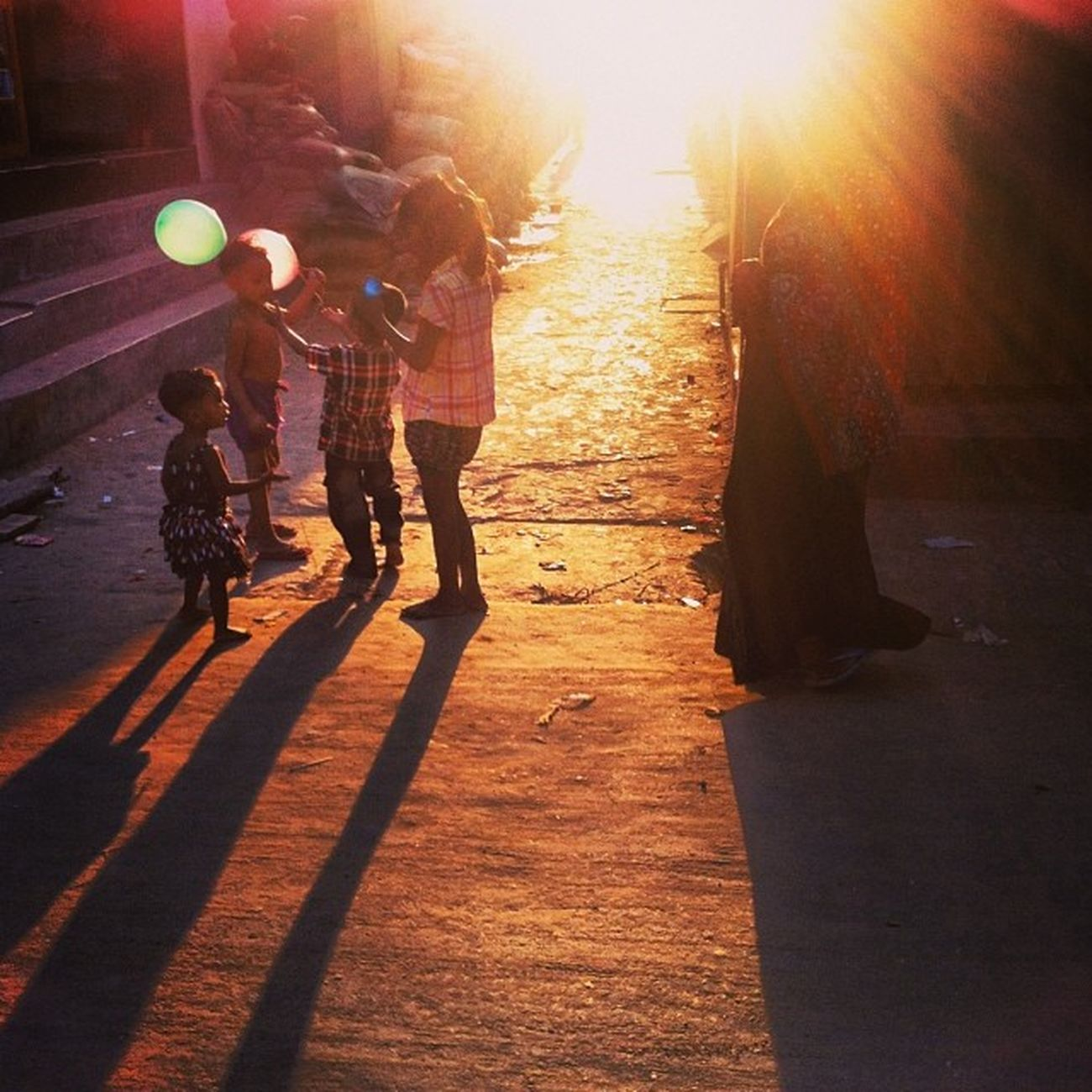 Sun Ray Light Shadow Winter Evening Children Play Balloon Street Chaktai Chittagong The Photojournalist - 2017 EyeEm Awards The Street Photographer - 2017 EyeEm Awards