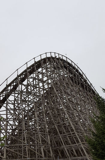 Rollercoaster Amusement Park Low Angle View Arts Culture And Entertainment Sky Sport Golf Club Amusement Park Ride Outdoors No People Day