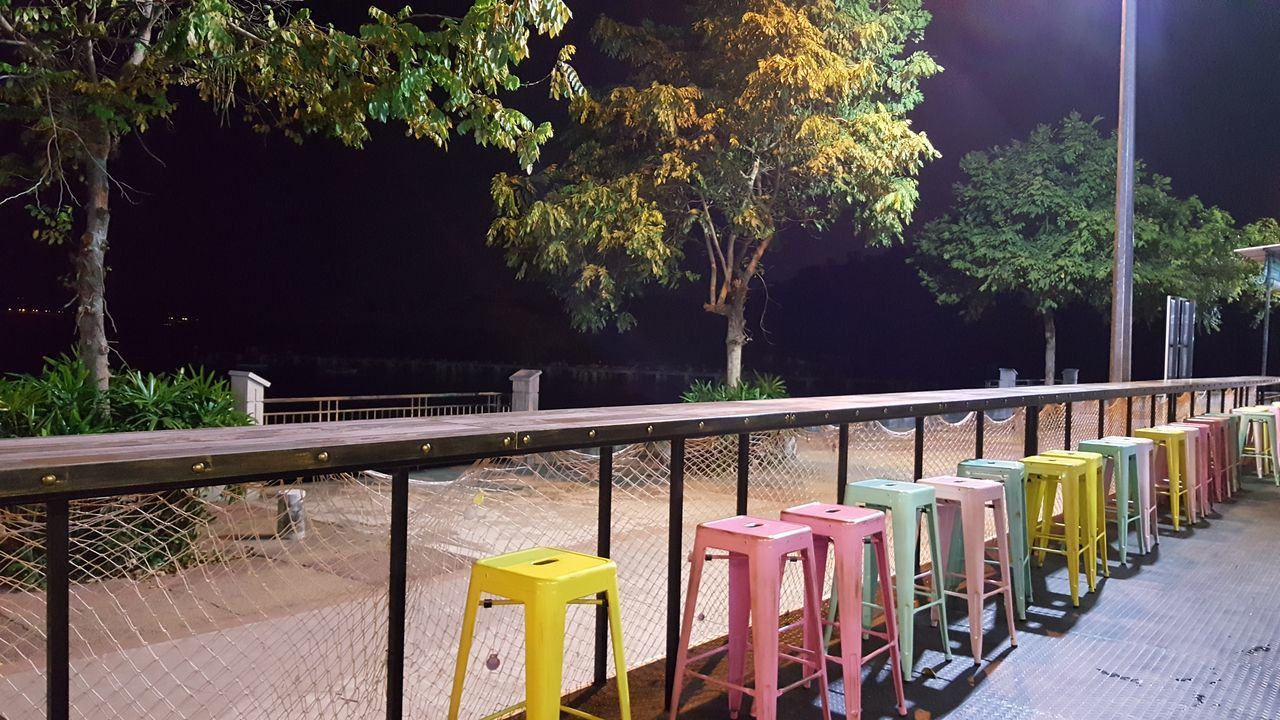 Multi Colored Tree No People Outdoors Night Nature Sky Colourful Stool Seaside View Night Lights Night View Nightsky Night Shot Relax Time  Be. Ready. Perspectives On Nature Karpal Singh Drive Food Court At Night Food Court Centre