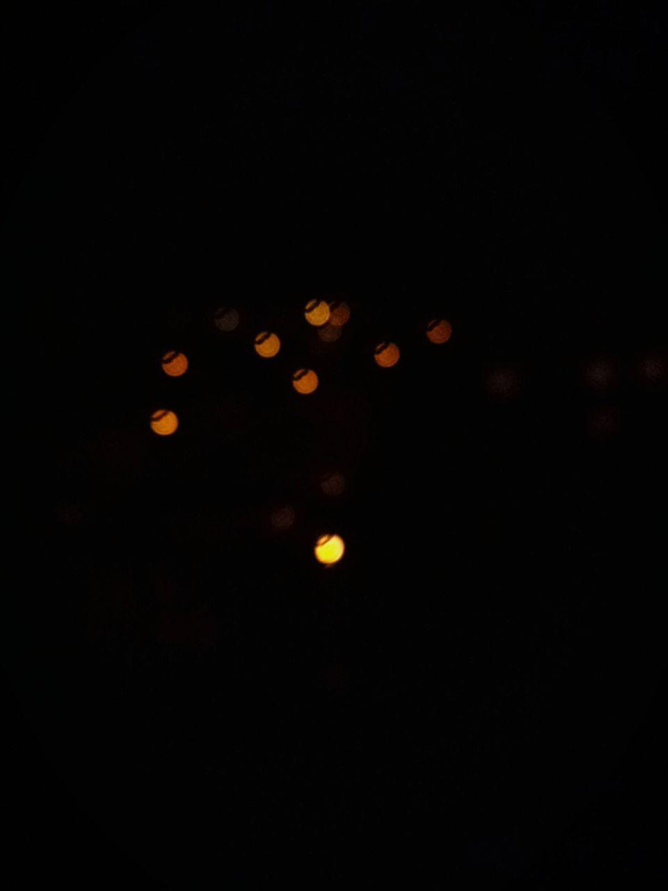 night, illuminated, defocused, no people, celebration, outdoors, black background, sky, close-up
