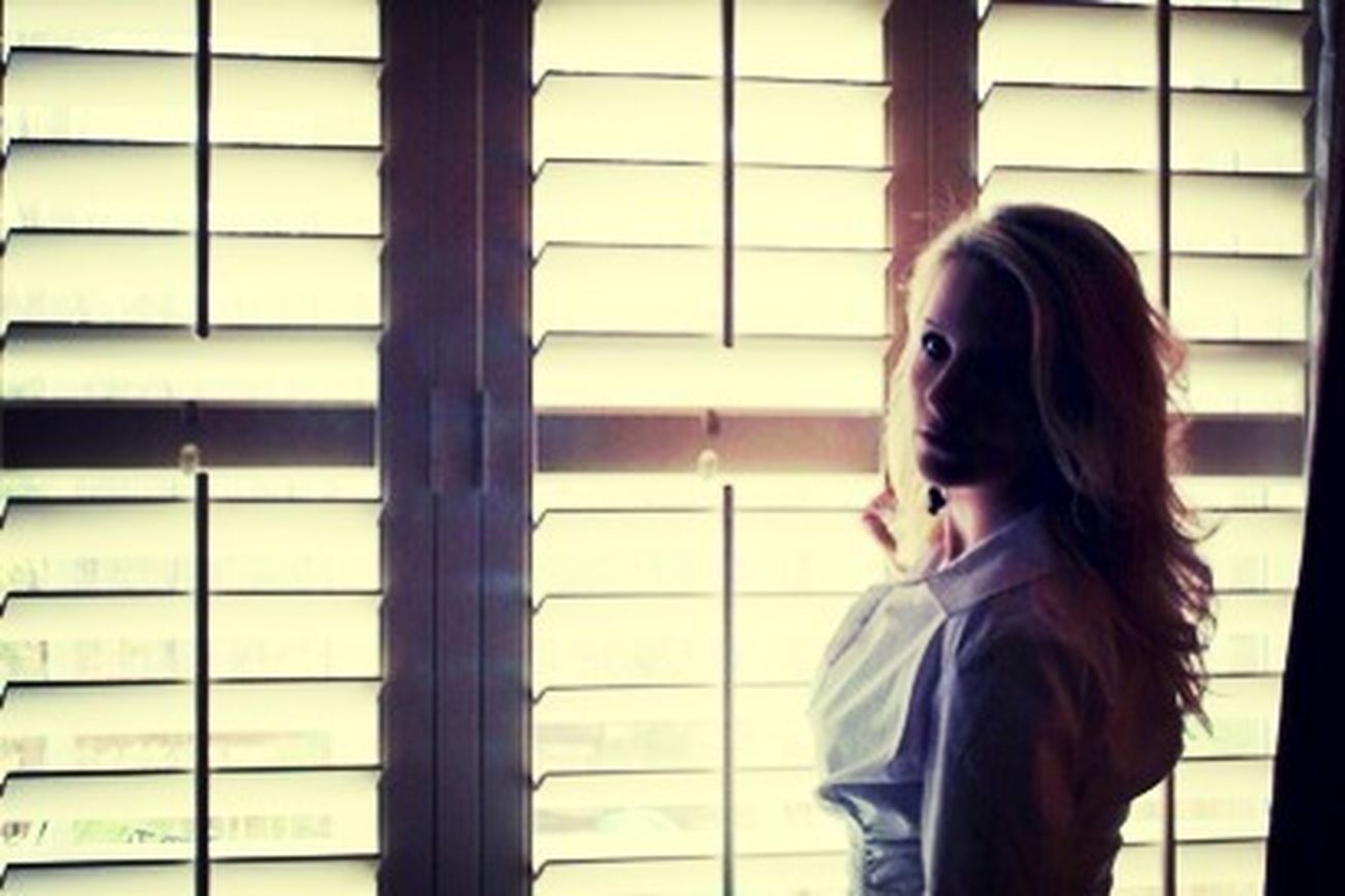 My daughter took this on her cell phone of me opening the blinds and I thought this was cool how the light was shinning in with the shadows... She caught me off guard!!