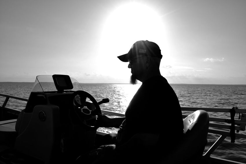 Silhouette of my husband driving our boat Beauty In Nature Boat Day Horizon Over Water Leisure Activity Lifestyles Men Mode Of Transport Nature Nautical Vessel One Man Only Outdoors Sitting Sky Slihouettes Sunlight Transportation