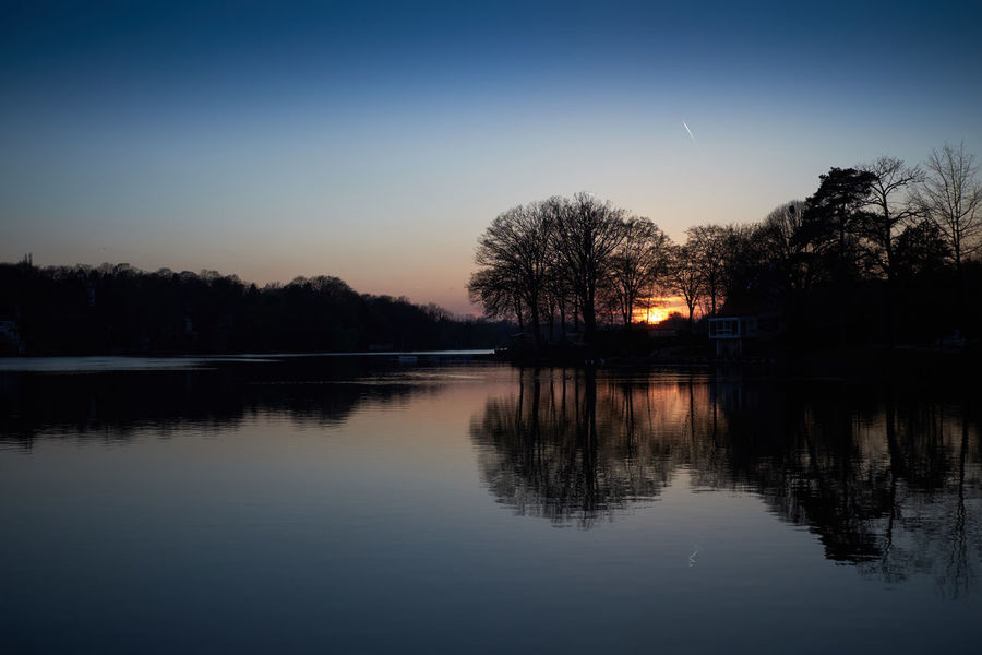 Lake Genval at sunset - Beauty In Nature Belgium Blue Dusk Genval Idyllic Lake Majestic Nature Reflection Scenics Silhouette Sky Sunset Tranquil Scene Tranquility Tree Wallonie Water Waterfront The Great Outdoors With Adobe Landscape
