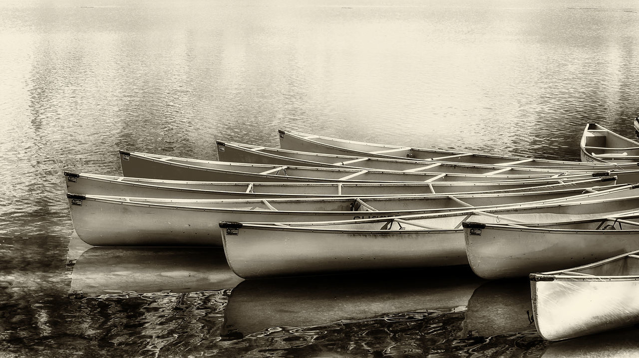 Canoes at lake Black And White Boat Canoes Day Lake Mode Of Transport Moored Nature Nautical Vessel No People Outdoors Peaceful Sepia Serene Transportation Water