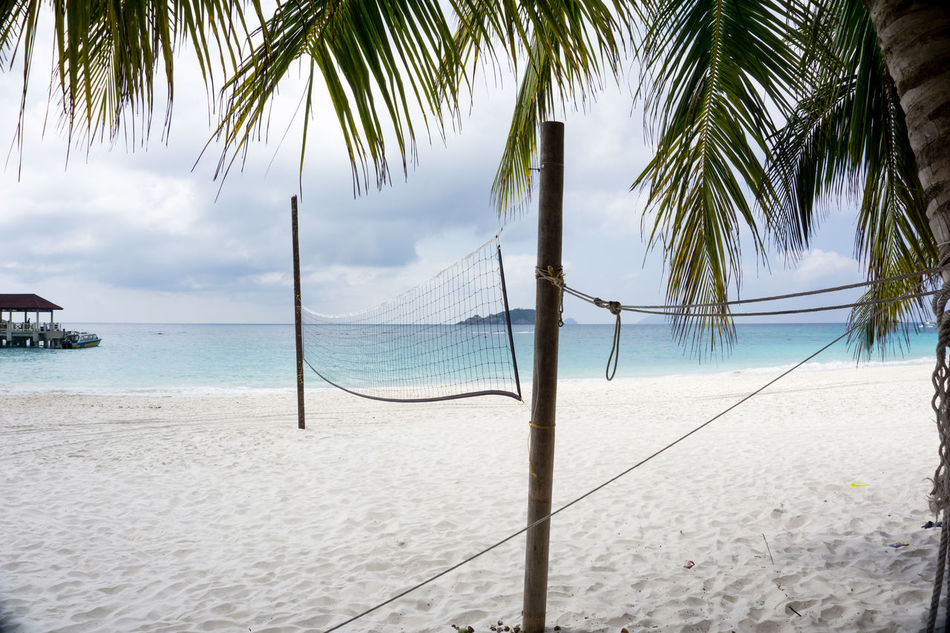 Beautiful island beach with nobody play volleyball Beach Beauty In Nature Calm Cloud Cloudy Coastline Day Growth Horizon Over Water Idyllic Nature Ocean Outdoors Palm Tree Redang Scenics Sea Shore Sky Tranquil Scene Tranquility Tree Tree Trunk Vacations Water