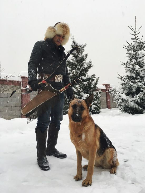 Dog Pets Domestic Animals One Animal Real People Full Length Mammal Leisure Activity One Person Winter Lifestyles Animal Themes Standing Tree Happiness Warm Clothing Snow Pet Owner Day Friendship Germanshepherd
