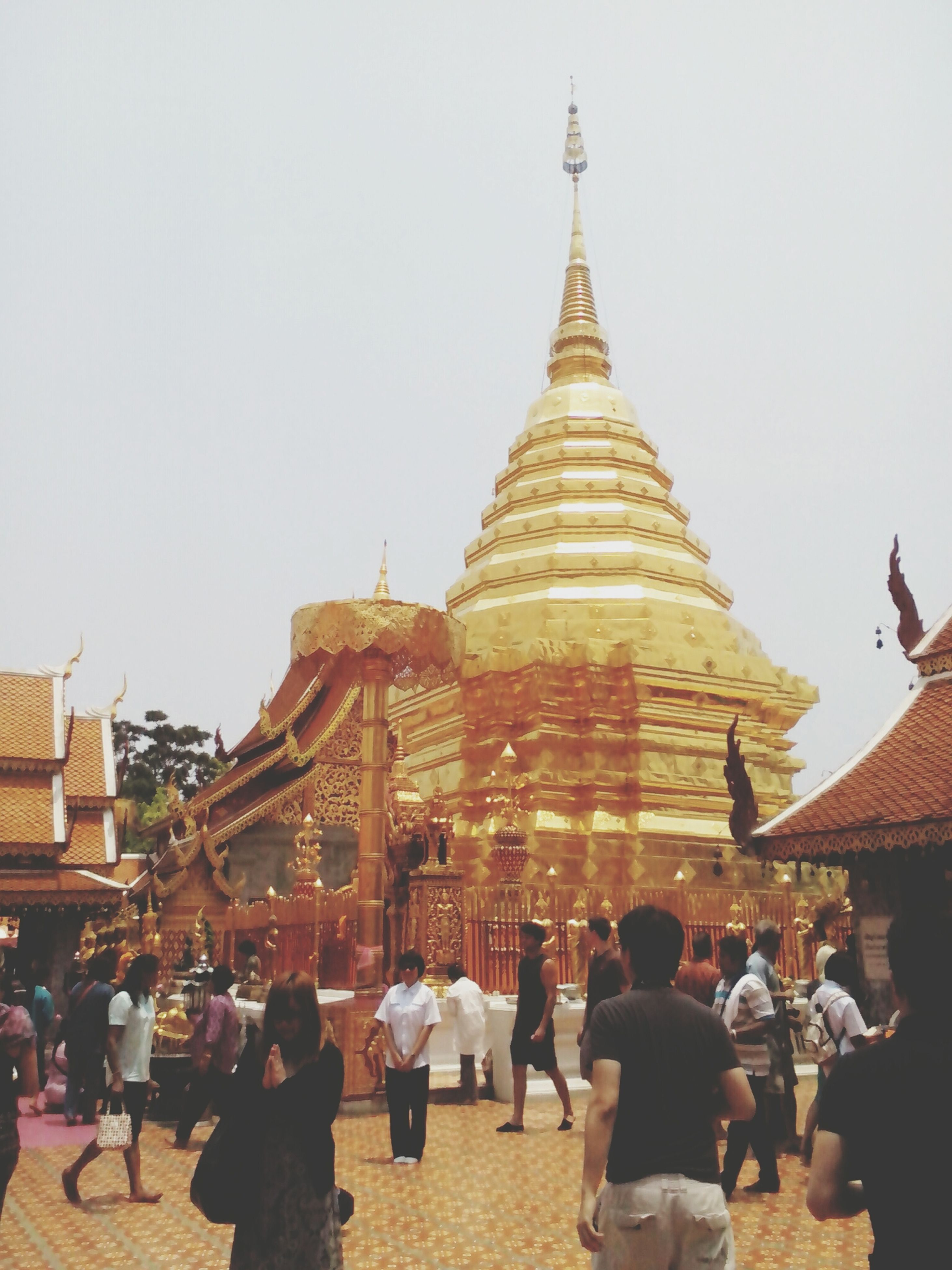 place of worship, religion, spirituality, architecture, building exterior, large group of people, built structure, famous place, tourism, travel destinations, temple - building, travel, cultures, person, history, clear sky, international landmark, tourist