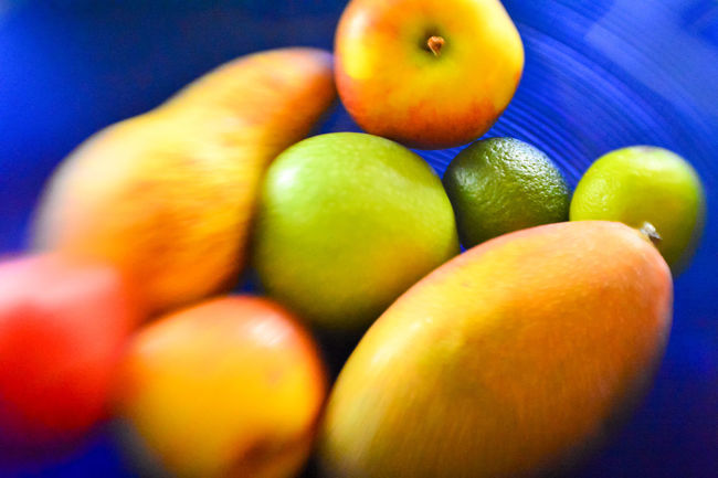 Abundance Apples Blue Close-up Food Food And Drink Freshness Fruits Group Of Objects Healthy Eating Indoors  Large Group Of Objects Manga Medium Group Of Objects Multi Colored No People Organic Pear Plate Retail  Selective Focus Vibrant Color Yellow