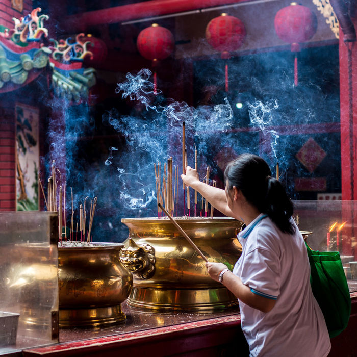 Chinese woman placing her incense stick on an altar Altar EyeEm Best Shots Faith Kuala Lumpur Lantern Red Smoke Taoist Tourist Tourist Attraction  Travel Adult Belief Chinese Day Eyeem People Flame Food Freshness Heat - Temperature Holding Human Hand Incense Incense Sticks Indoors  Jostick Malaysia Men One Person People Praying Preparation  Real People Religion Street Photography Taoim Temple Travel Destinations Women