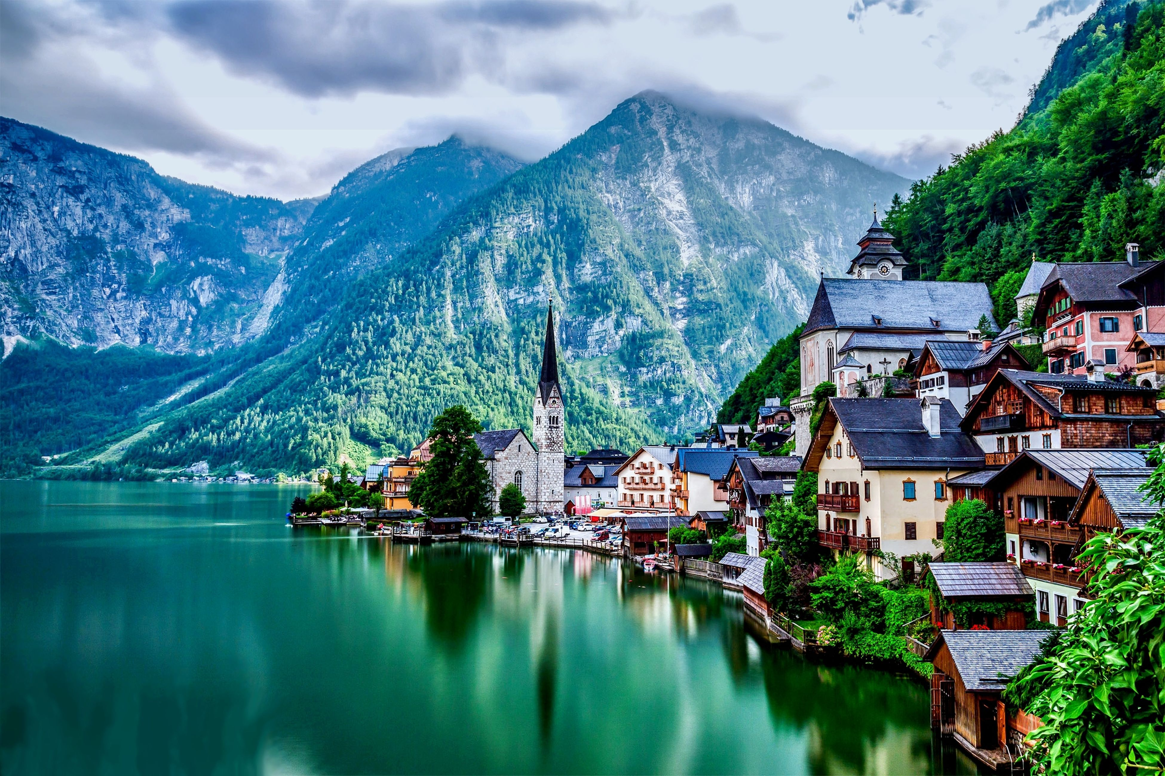 mountain, water, mountain range, building exterior, waterfront, lake, architecture, built structure, tree, reflection, house, sky, scenics, tranquil scene, tranquility, beauty in nature, nature, river, town, residential structure